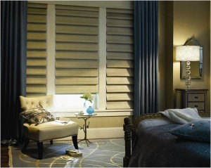 shades layered with drapes in bedroom